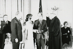 Hills being sworn in as Secretary of Housing and Urban Development in 1975