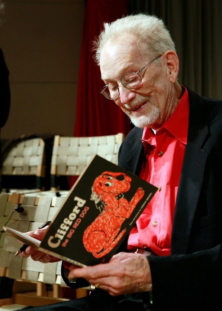 Bridwell in 2011, holding a copy of the first ''[[Clifford the Big Red Dog]]'' book.