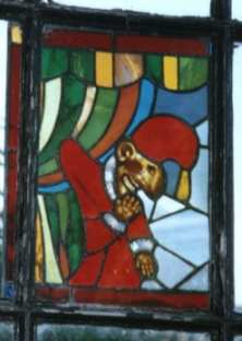 A stained glass image of Mr Punch by Steve Ignorant displayed at Dial House, Essex Punch.jpeg
