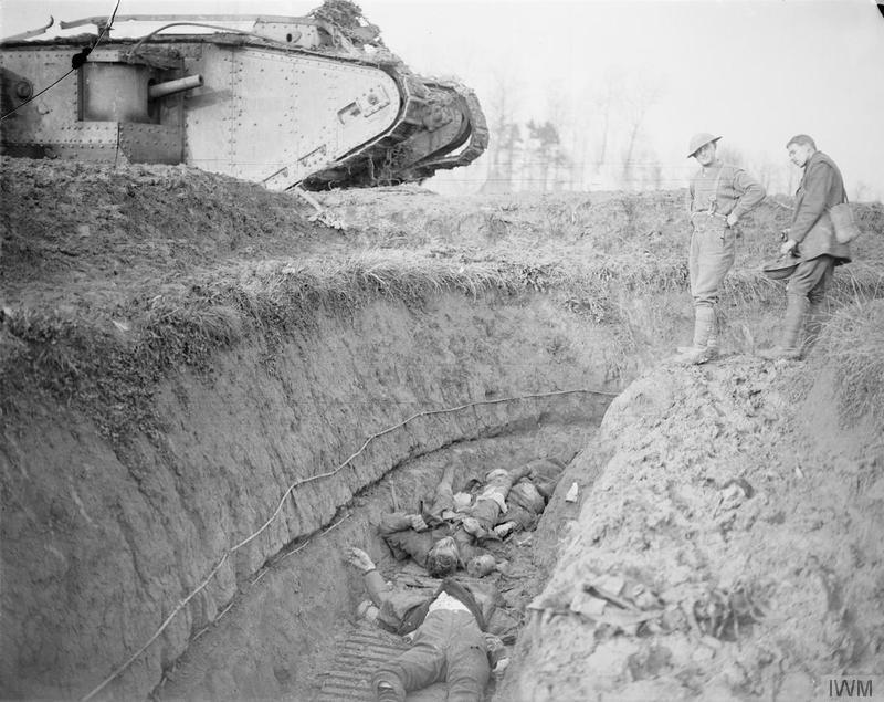 A British Mark IV tank at the lip of a German trench