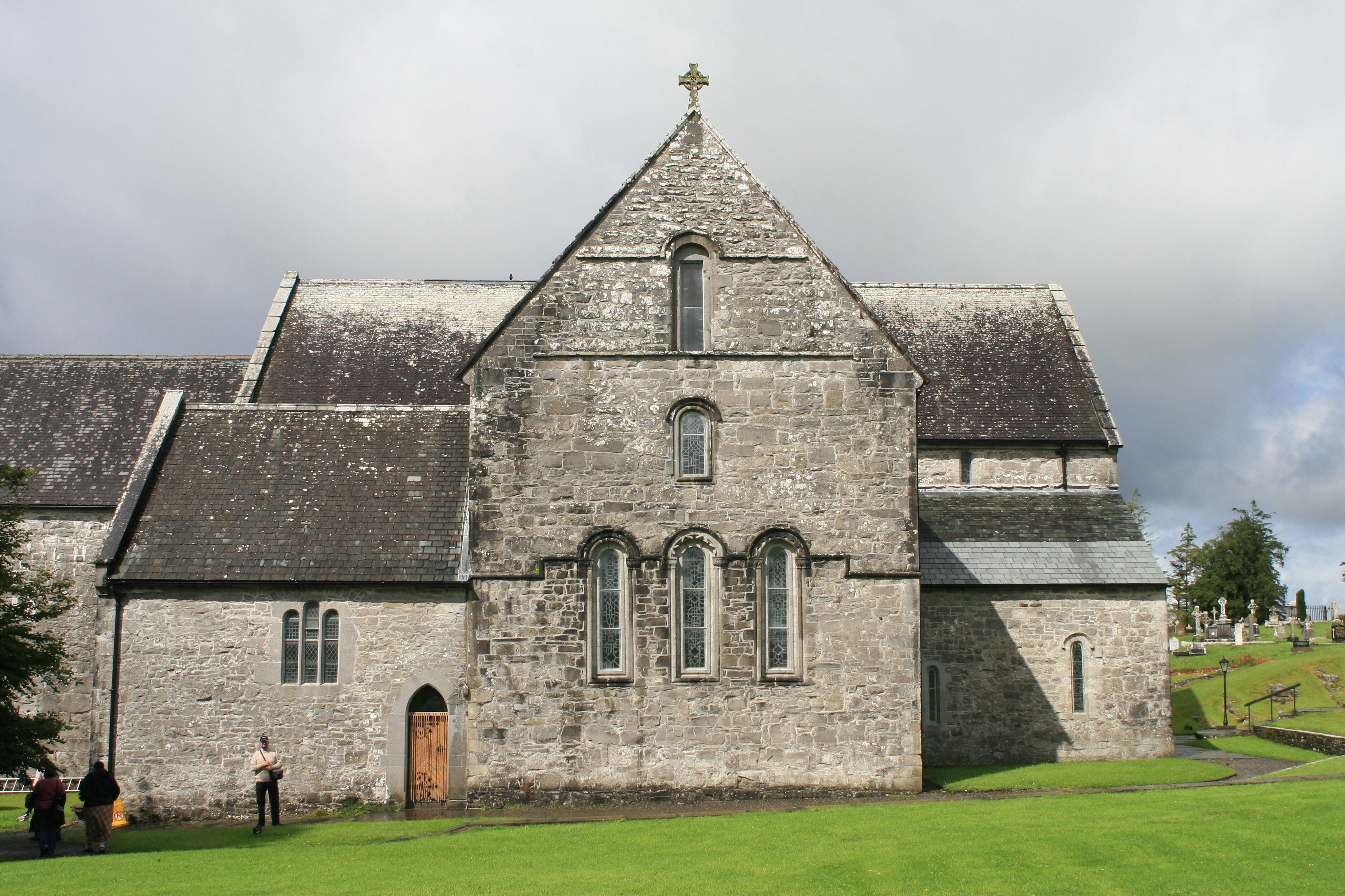 Ballintubber Abbey, An Augustinian priory founded in the 13th century, suppressed in 1603 and burned in 1653; but continuallly re-occupied and used for Catholic services, and re-roofed in the 20th century
