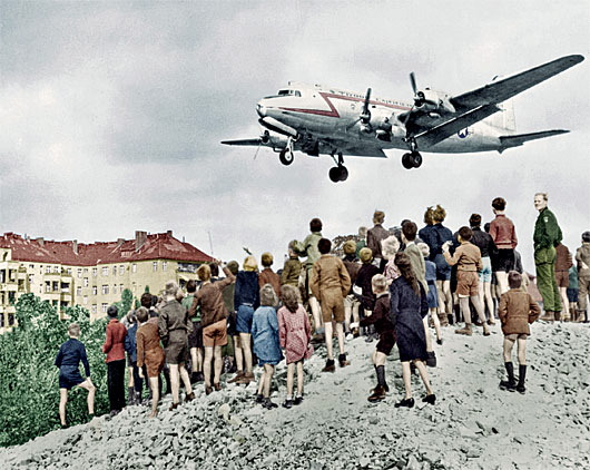 Berliners watching a C-54 land at Berlin Tempelhof Airport, 1948