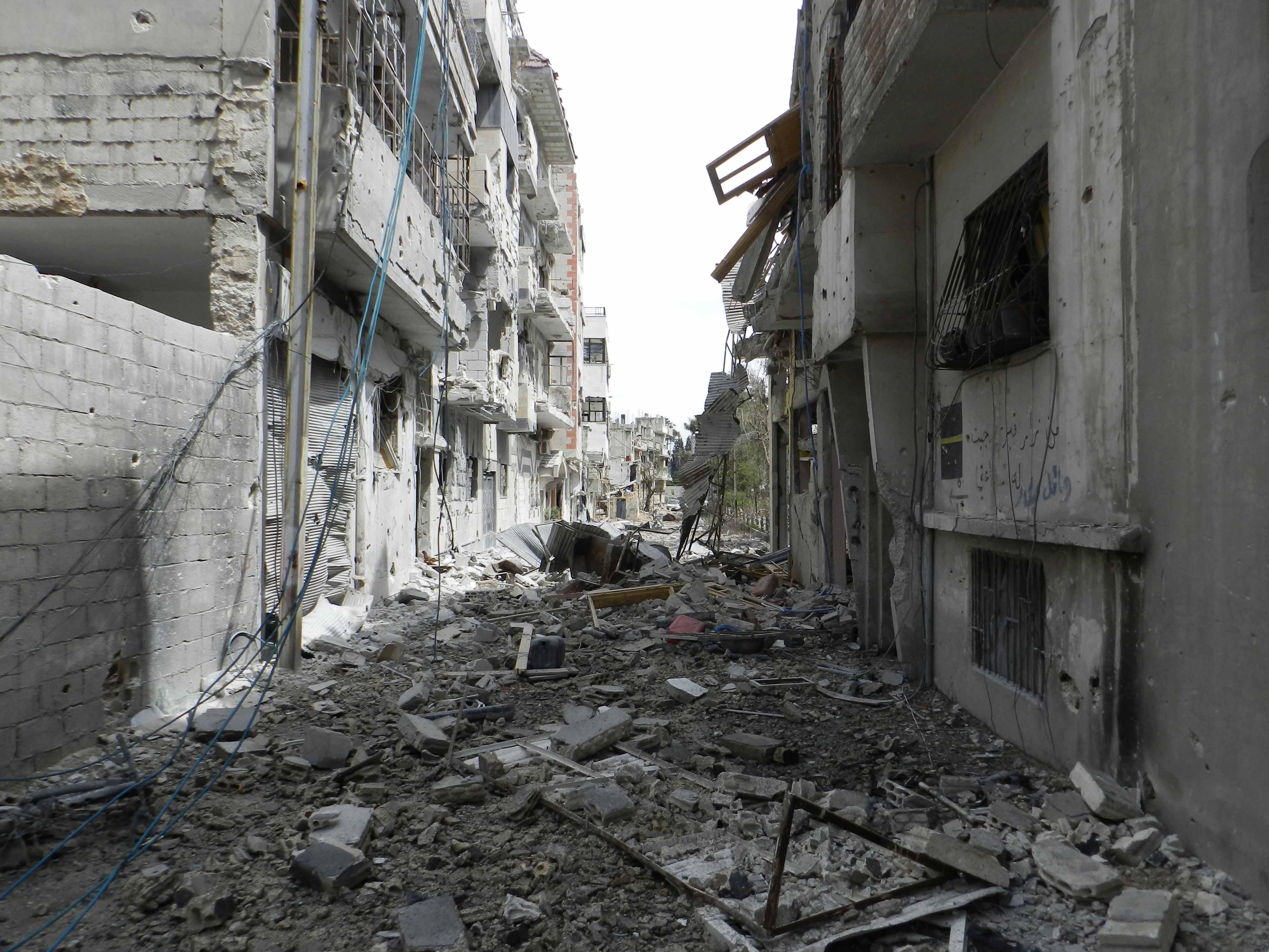 Durch Bürgerkrieg zerstörte Gebäude in Homs (Wikipedia)