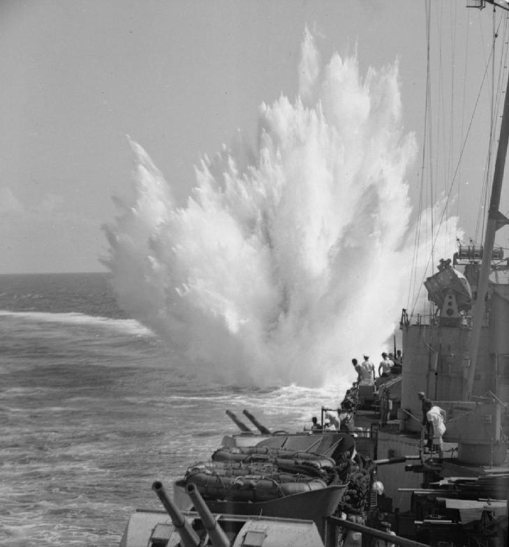 IWM caption : A depth charge explodes after it...
