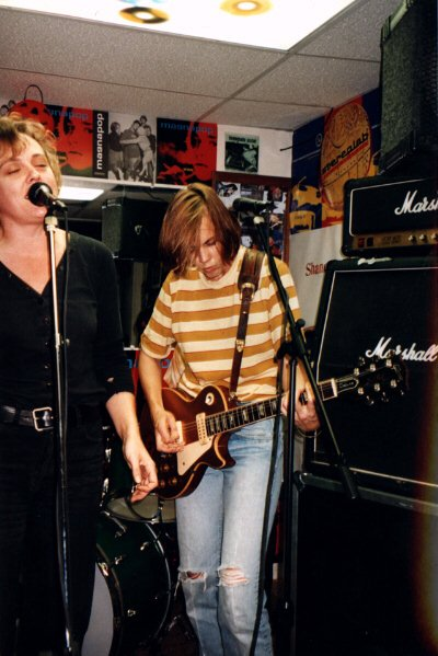 Record shops also host musical performances, especially on Record Store Day: Magnapop are pictured here playing at an American store in 1994, with flyers for their album Hot Boxing visible in the background Linda Hopper and Ruthie Morris 1994 02.jpg