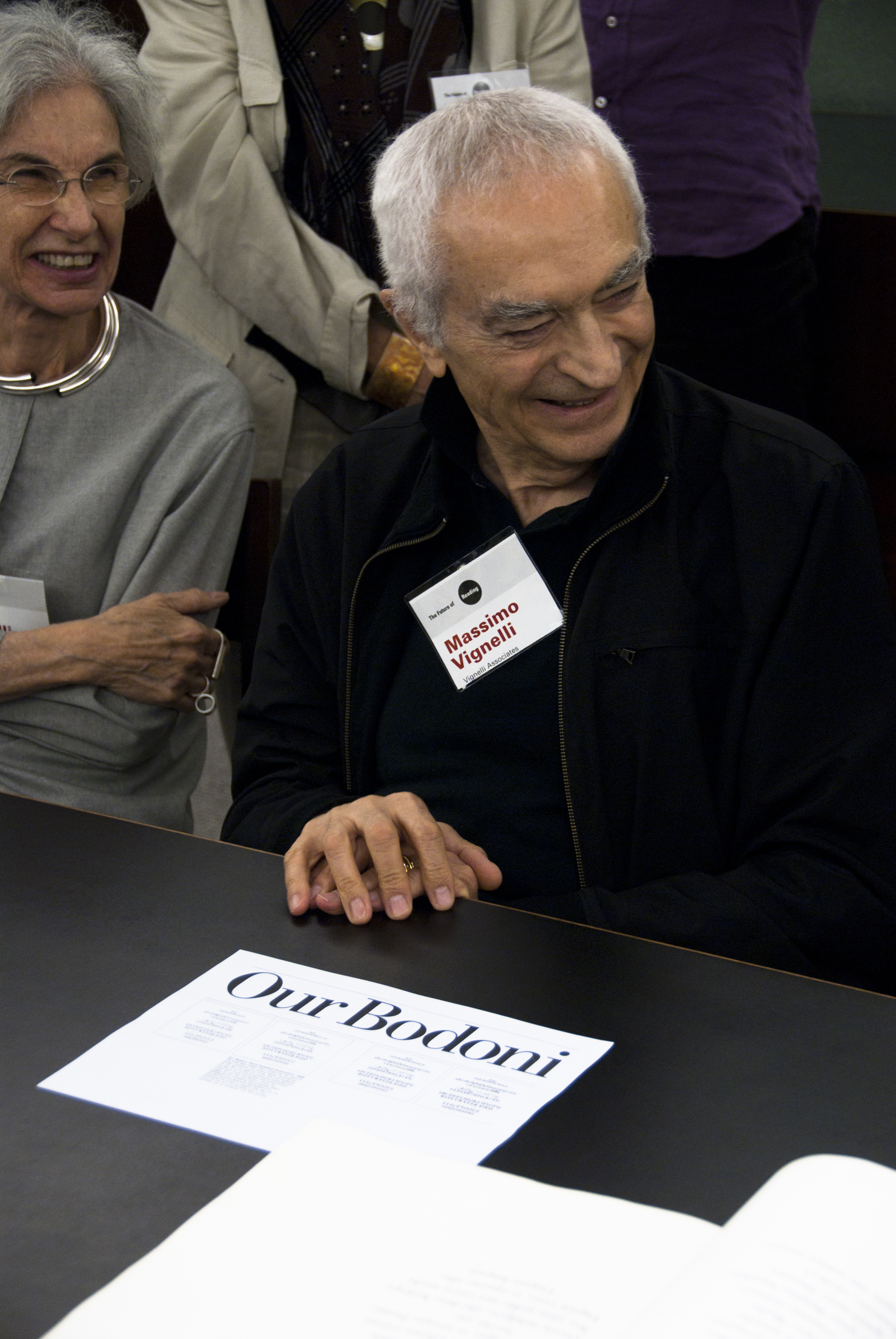 Massimo Vignelli and Lella at the [[RIT]] Cary Graphic Arts Collection with a specimen of his typeface, Our Bodoni.
