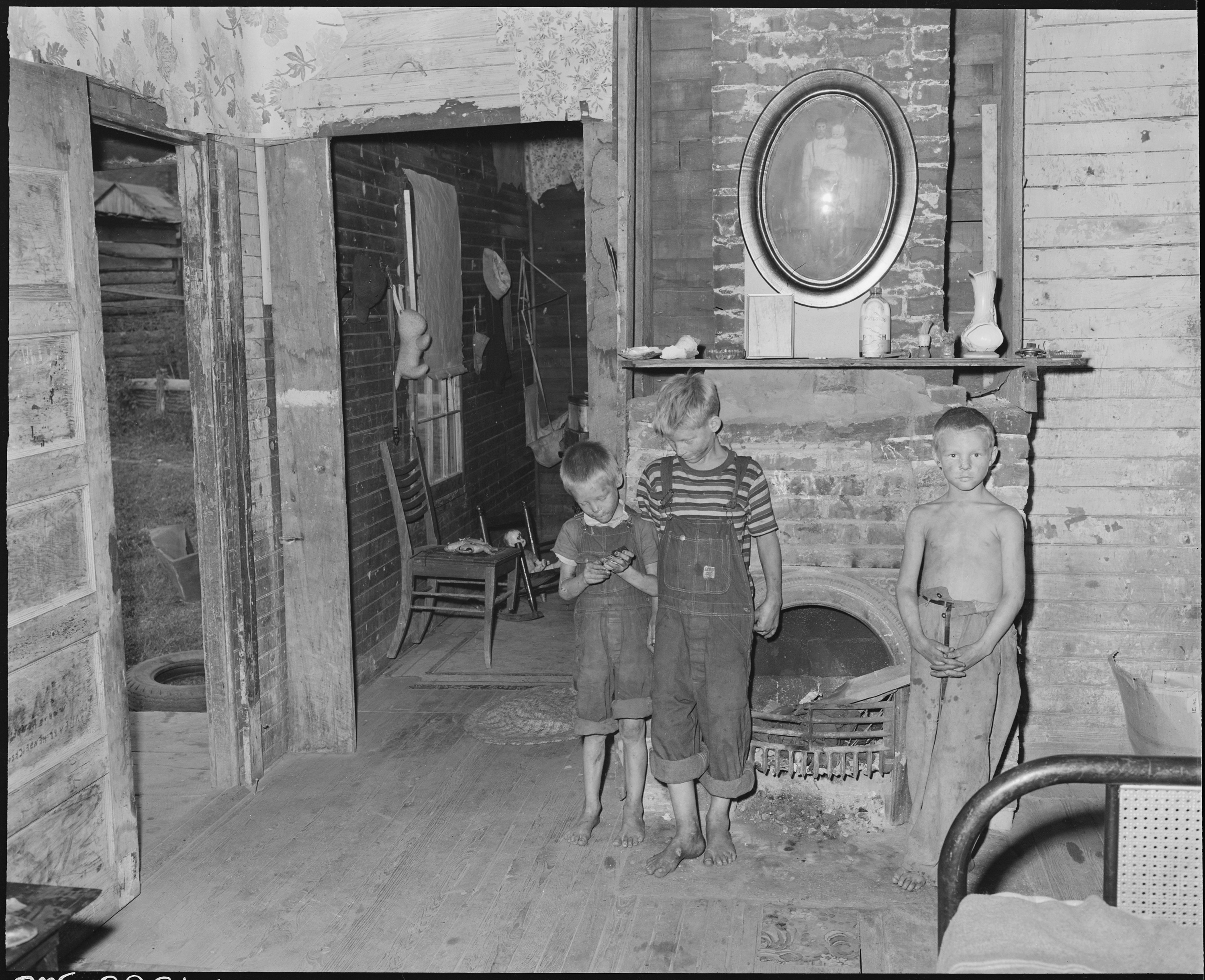 file miners children in front of the fireplace in monroe jones