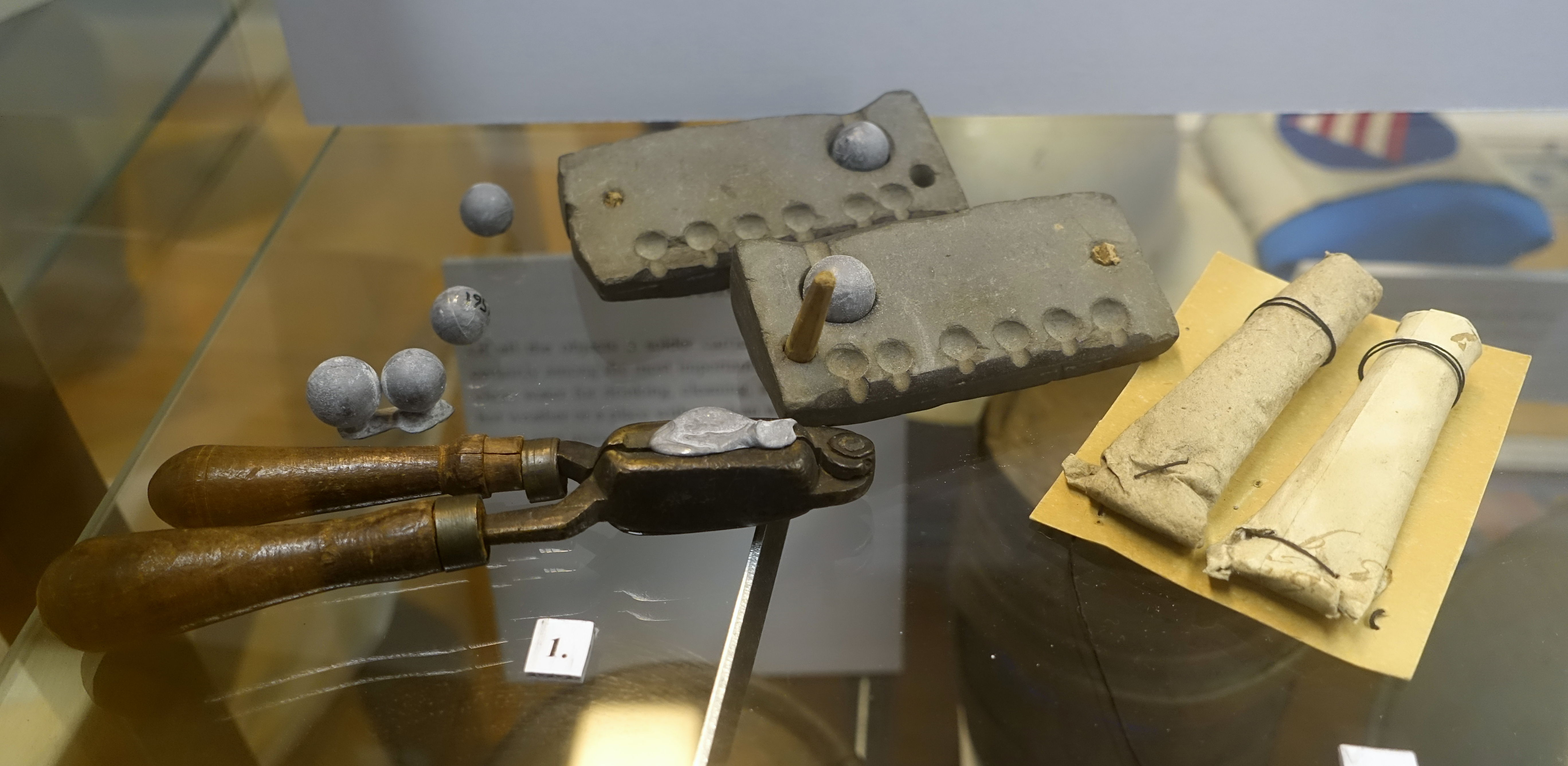 File:Musket balls, bullet molds, and paper cartridges