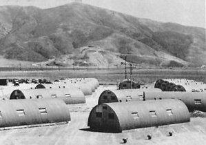 Quonset huts in front of Laguna Peak, Point Mu...