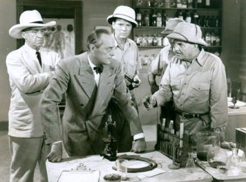 Left to right: MacDonald, Frey, Banks, and Buck in the film Tiger Fangs (1943) film still 01.jpg
