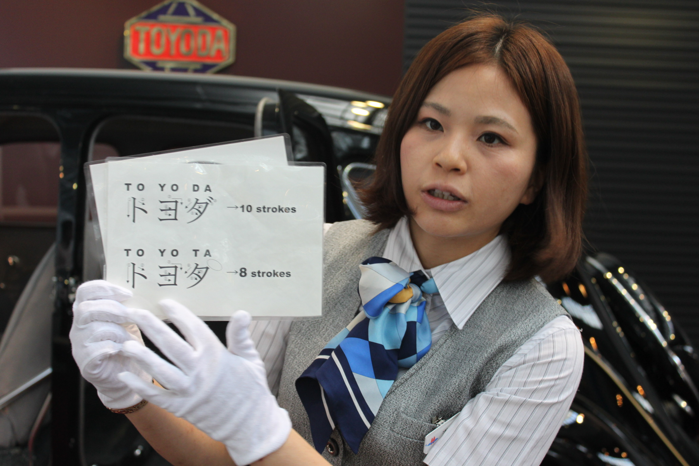 employee at toyota museum explains development of toyota name and