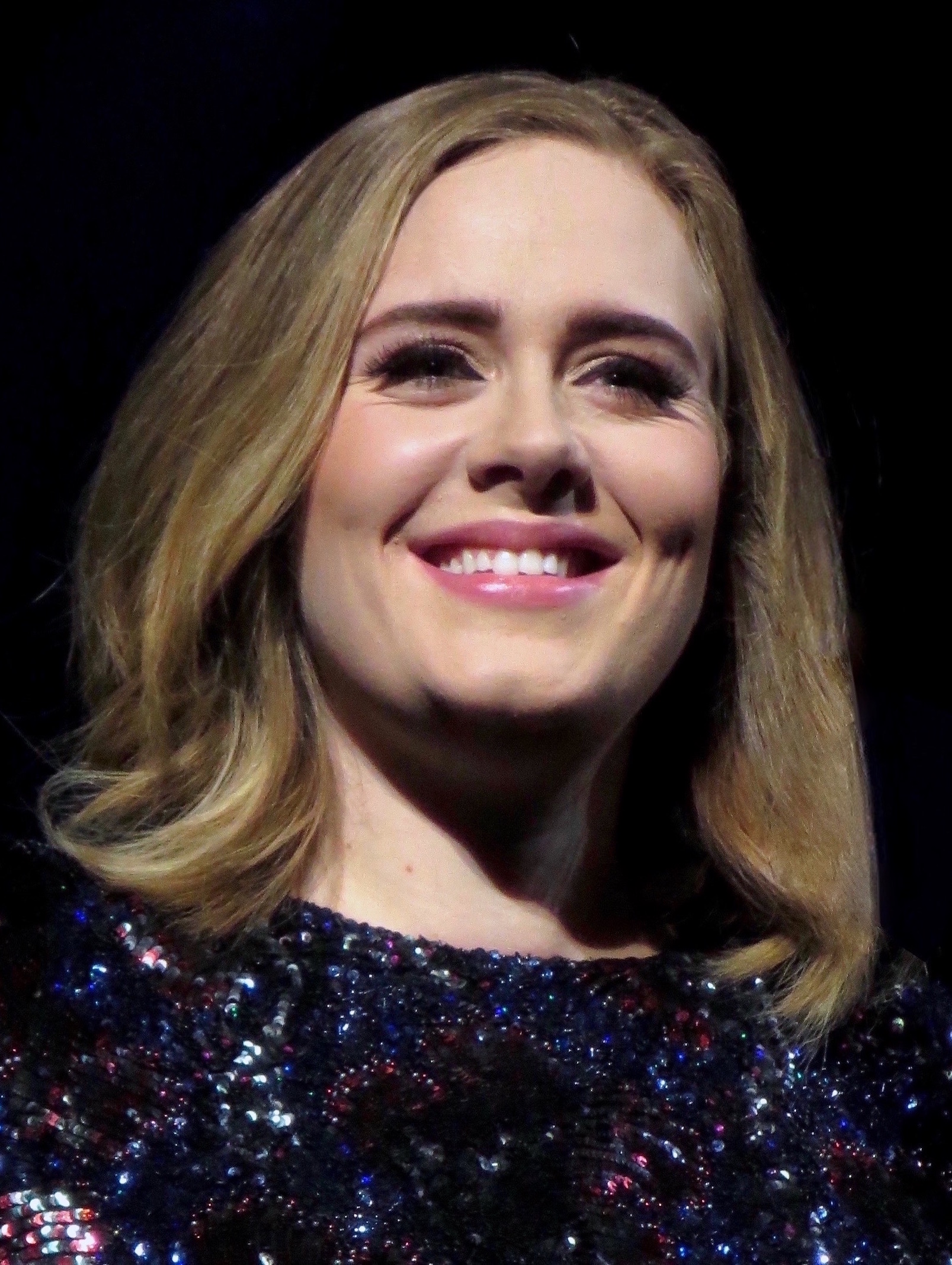The 29-year old daughter of father Mark Evans and mother Penny Adkins, 175 cm tall Adele in 2018 photo