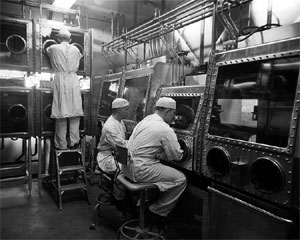 Researchers working in Class III cabinets at the U.S. Army Biological Warfare Laboratories, Camp Detrick, Maryland (1940s). B-w-scientists.jpg