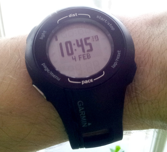 Close-up of a wrist pedometer with the time on it.