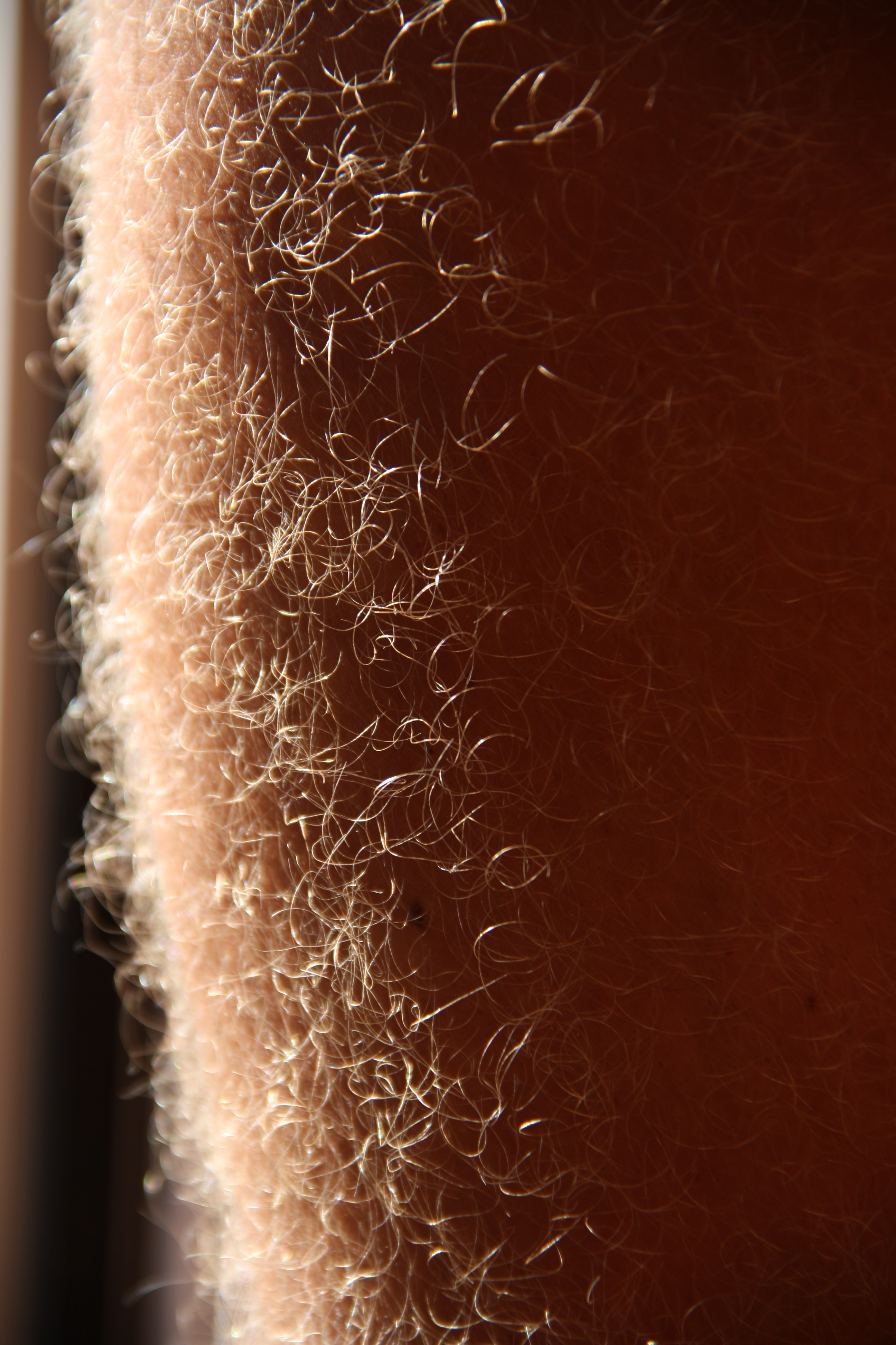 Hairy legs black girl thumbs something and