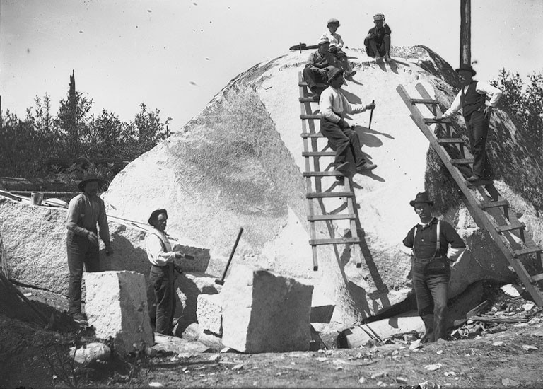Men with ladders and stone cutting tools quarrying large rock, Bismarck, Washington, ca 1905 (BAR 207)