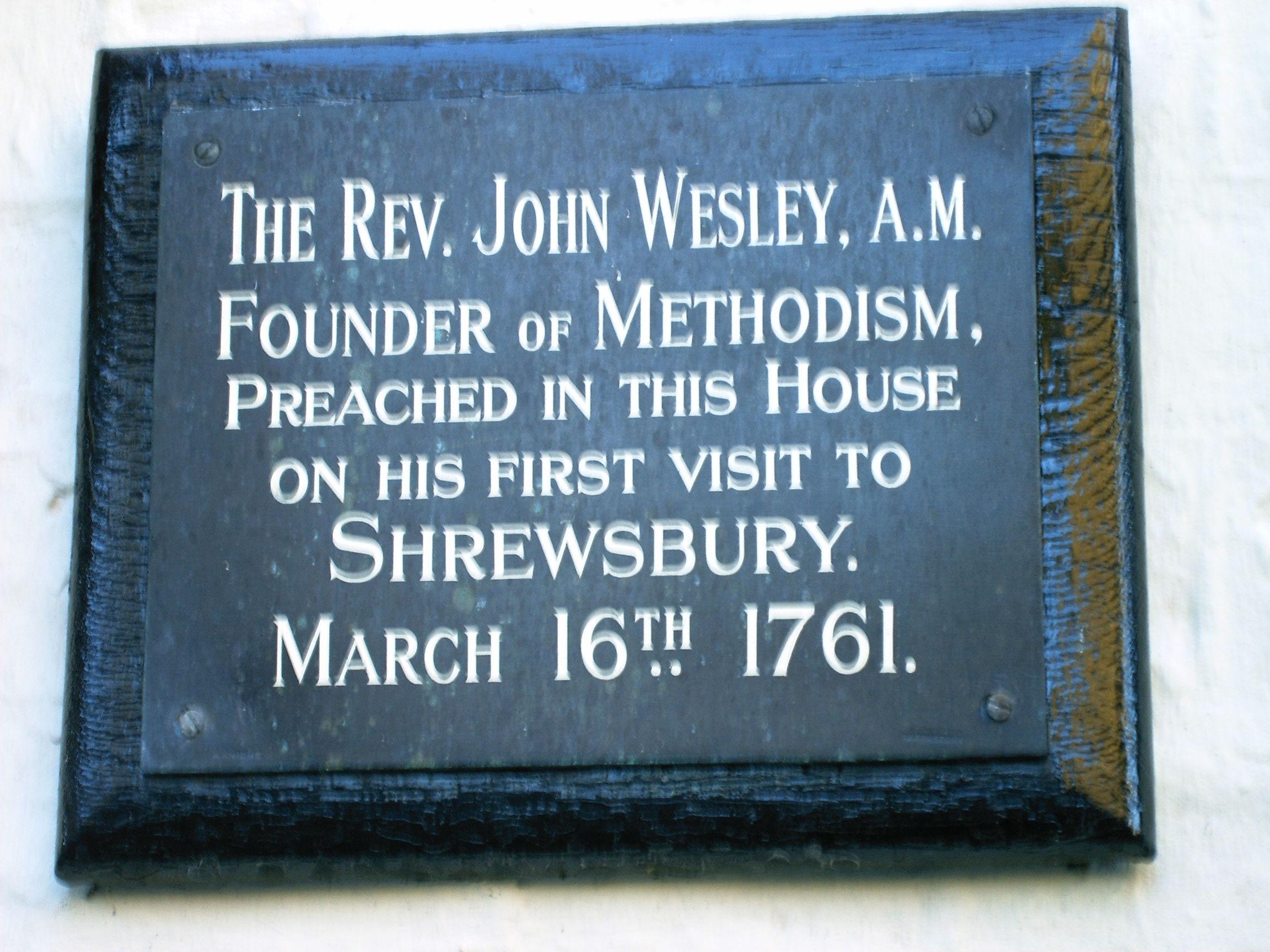 Photo of John Wesley black plaque