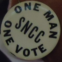 One man, one vote button which was probably worn at an SNCC event