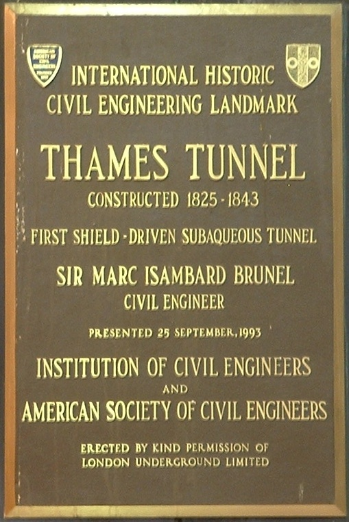Marc Isambard Brunel and Thames Tunnel brown plaque - Thames Tunnel constructed 1825-1843 first shield-driven subaqueous tunnel. Sir Marc Isambard Brunel civil engineer.