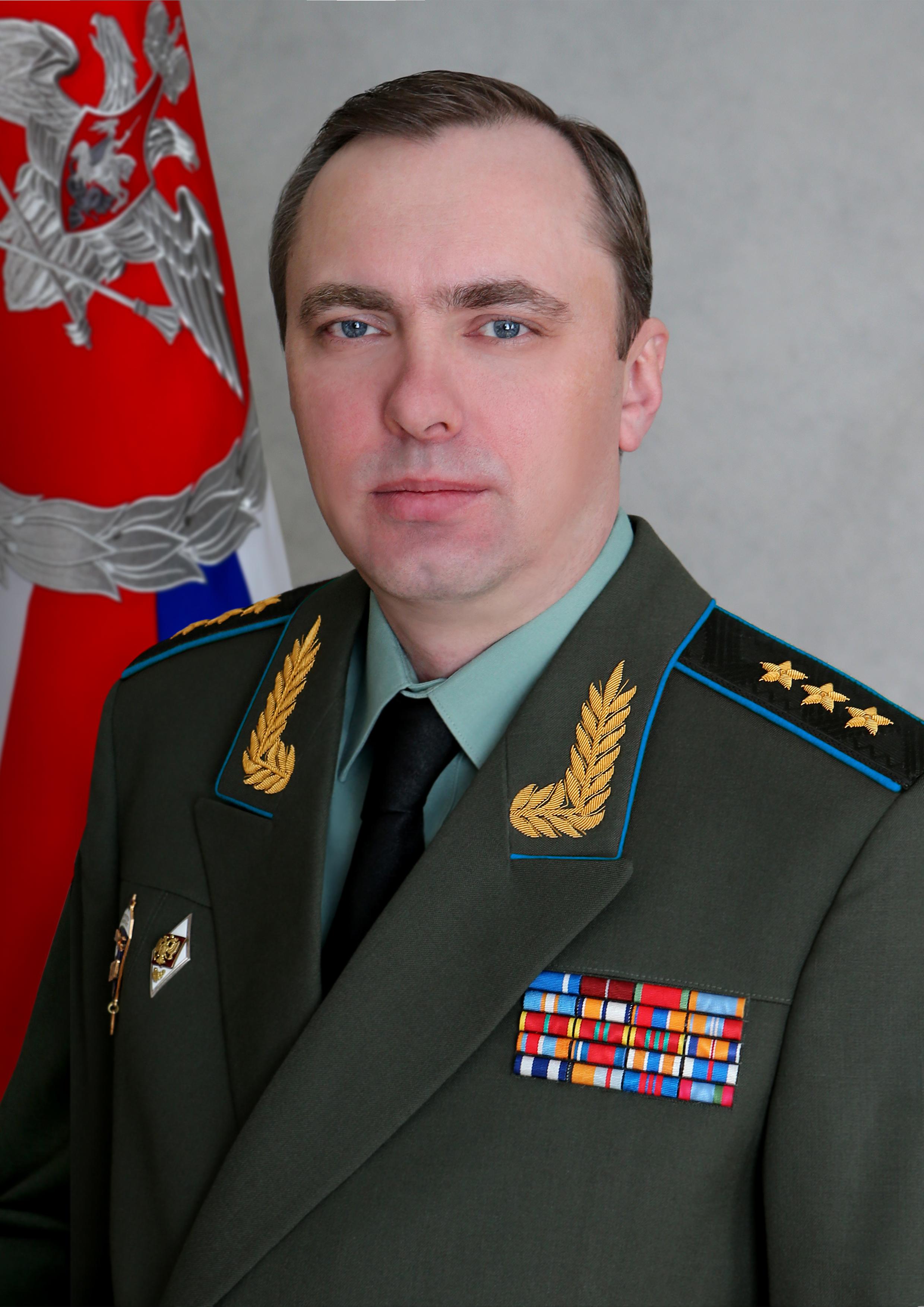 https://upload.wikimedia.org/wikipedia/commons/7/7c/Yuriy_Sadovenko_%28General%29.jpg