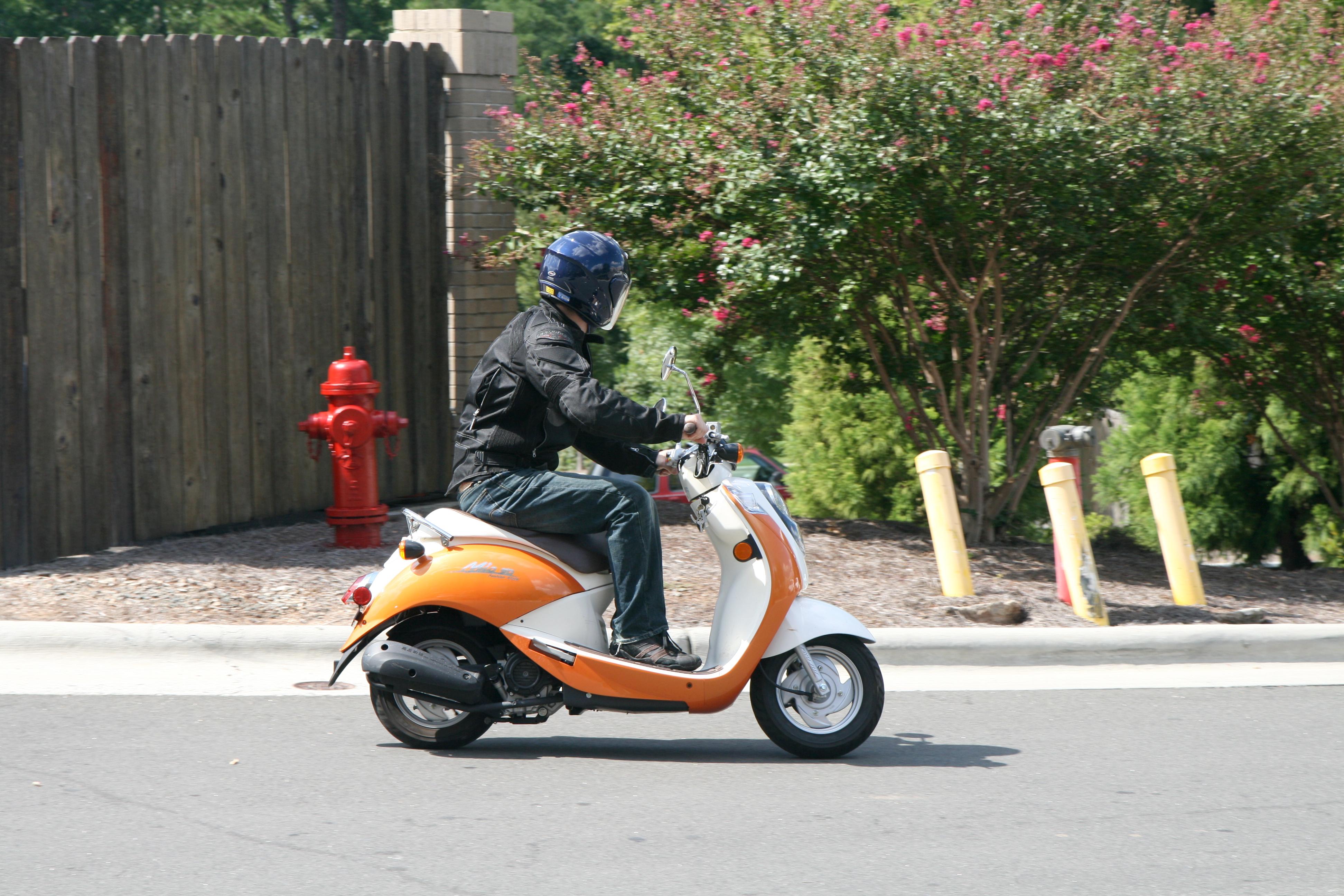 File 2011-09-10 Rider On Sym Mio Scooter Jpg