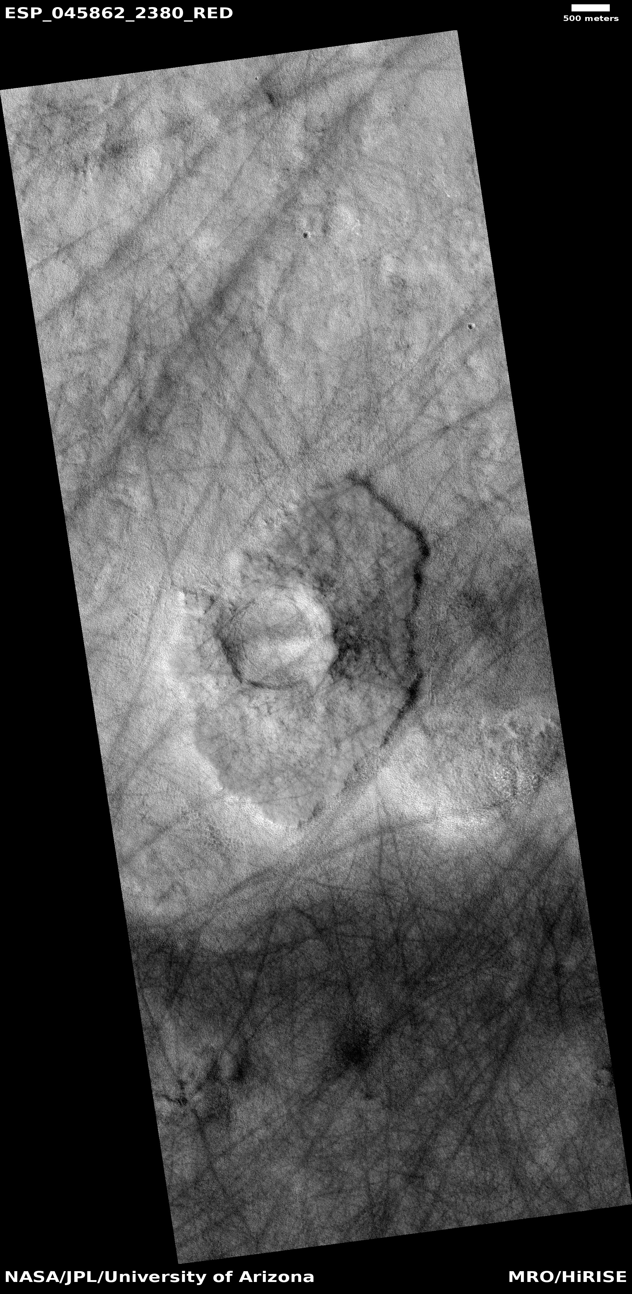 Pedestal crater and dust devil tracks