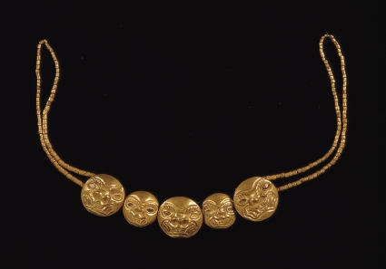 Moche gold necklace depicting feline heads. Larco Museum Collection, Lima, Peru. MocheGoldNecklace.jpg