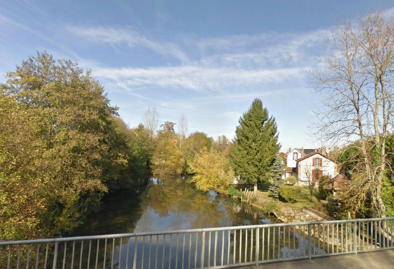 The Ouanne river at Charny, Yonne, France. The photo is taken from the Rue des Ponts, looking downstream and towards the west of the village.