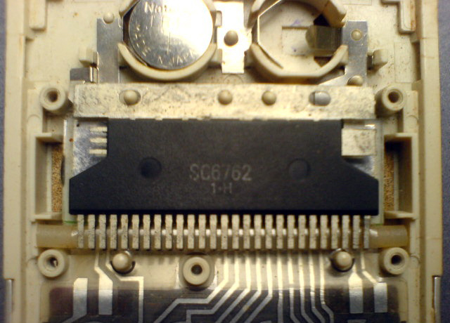 The processor chip (integrated circuit package) inside a 1981 Sharp pocket calculator, marked SC6762 1.H