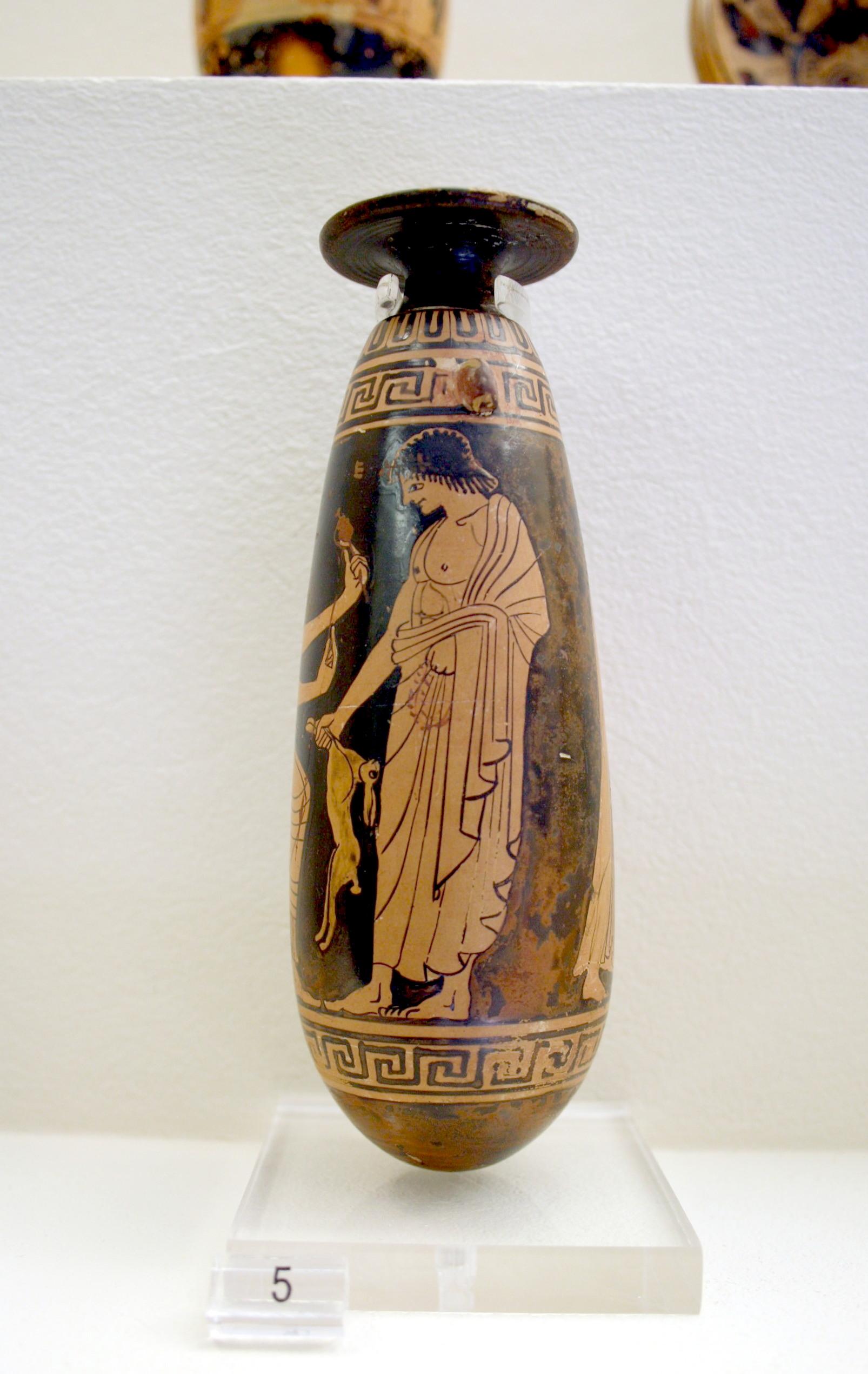 Alabastron a figure rosse con scena di corteggiamento pederastico