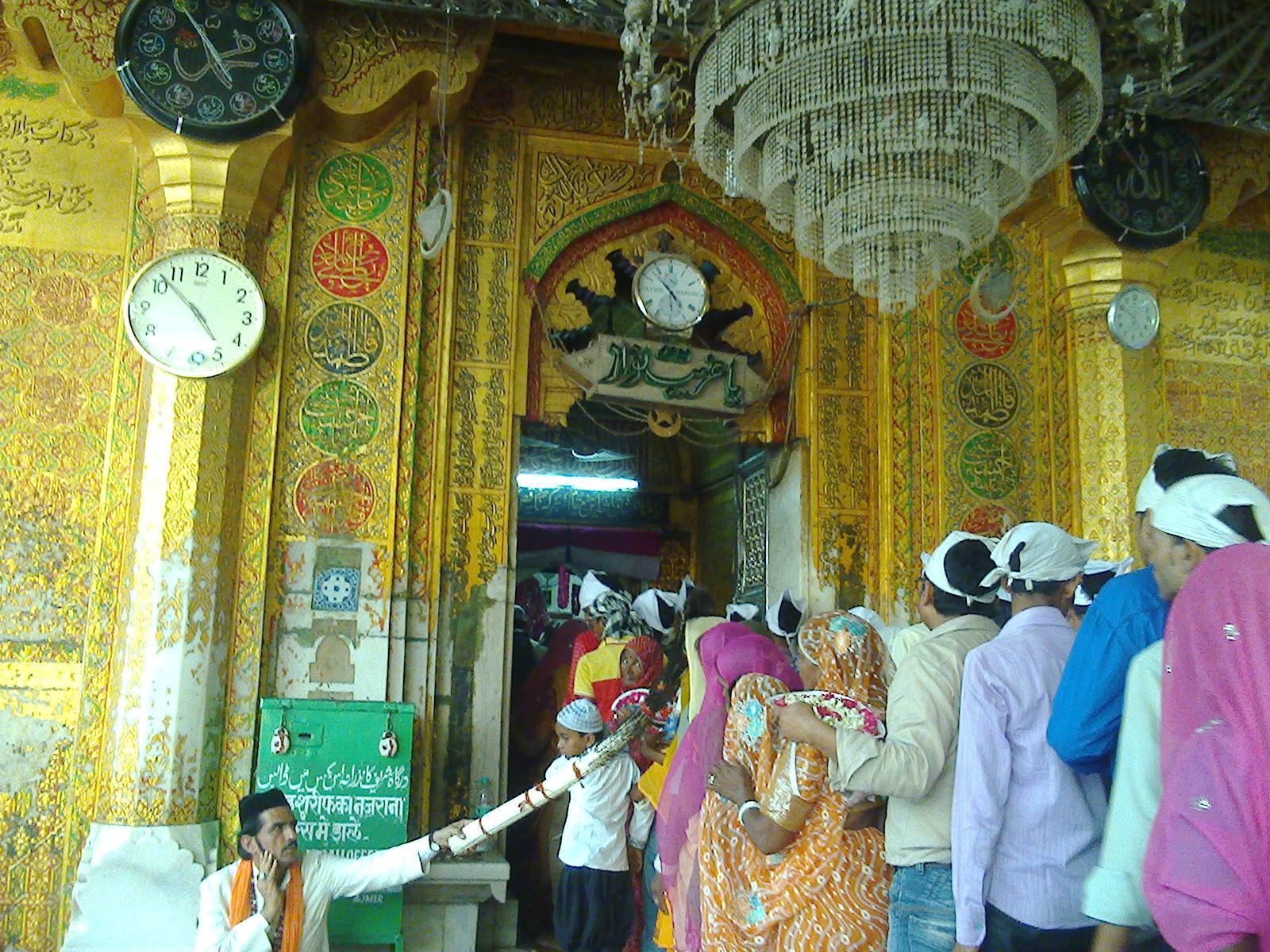 Devotees entering the dargah sanctum