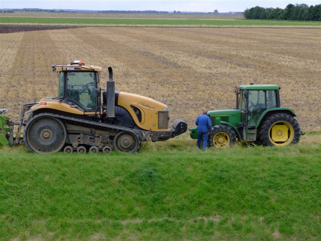 john deere tractor in field. file:challenger and john deere tractors.jpg tractor in field