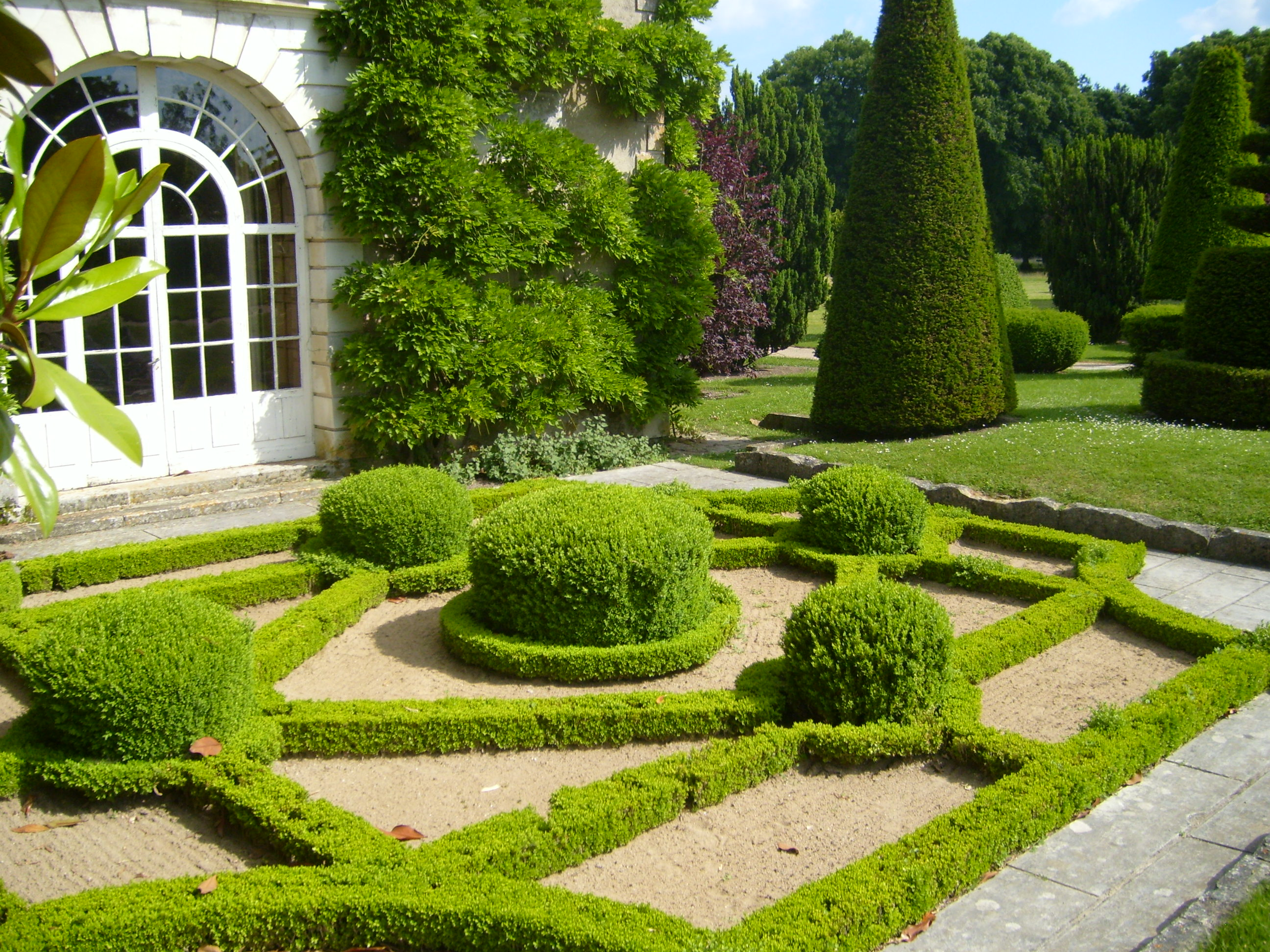 Garden-French-style-white-door-design-and-grass-with-special-form