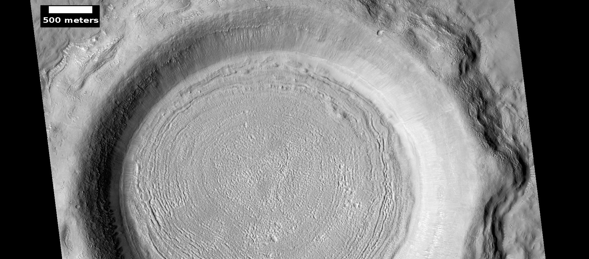 Crater floor showing concentric crater fill, as seen by HiRISE under HiWish program