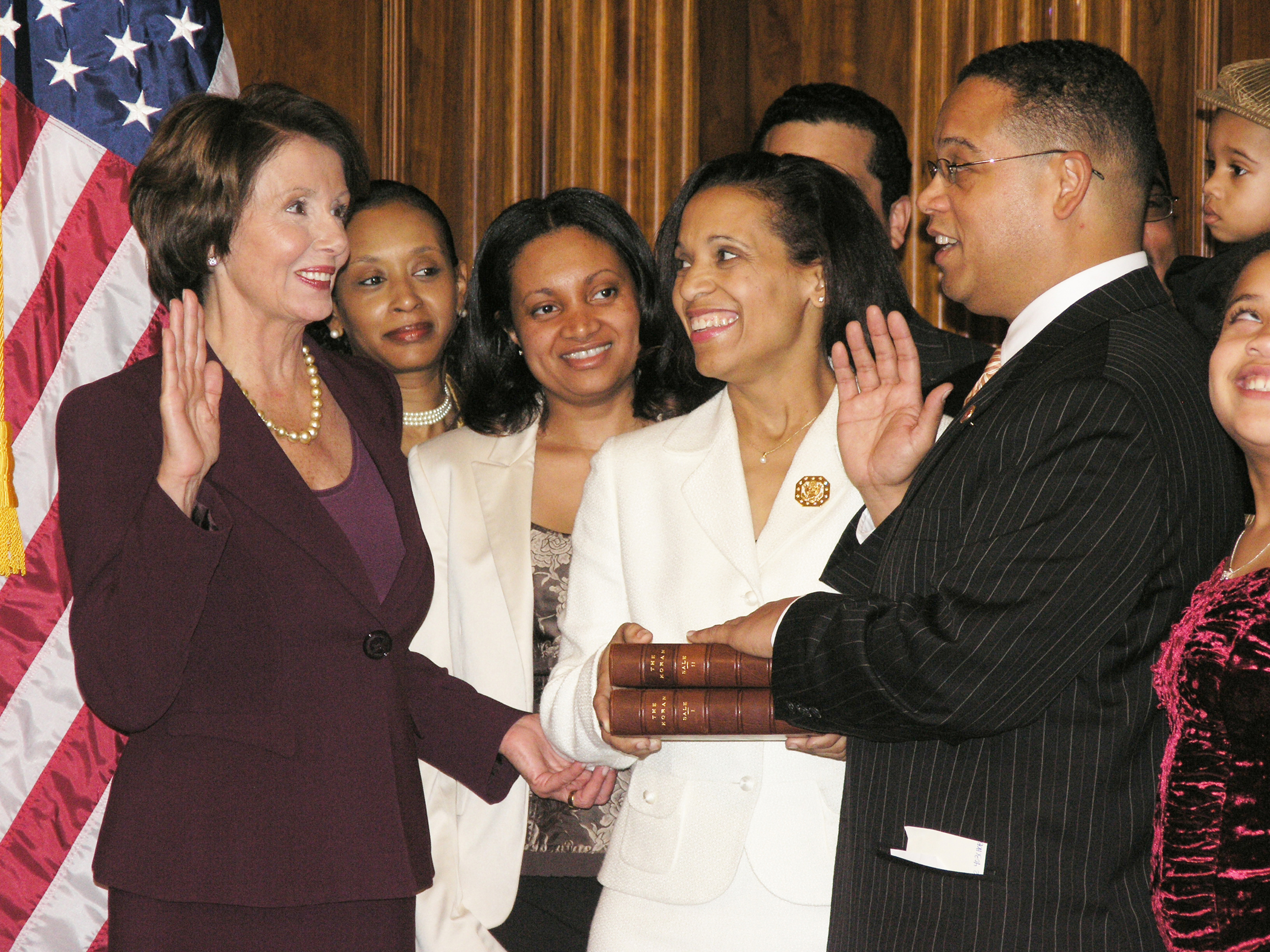 Ex-House Speaker Nancy Pelosi (left) swearing Congressman Ellison's with Jefferson's Qur'an, January 2007