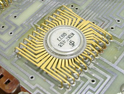 A Soviet MSI nMOS chip made in 1977, part of a four-chip calculator set designed in 1970<!-- cite web -->