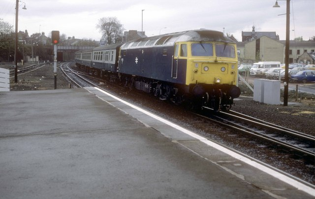 "The train from Dundee arrives at the station for Edinburgh, at Kirkcaldy, Fife, Scotland. Loco hauled services in Fife as seen in 1985 when the majority were hauled by class 47 locos. These services were some of the last to use ""steam heat"" rather then electric train heating. In simple terms the locos had a boiler which produced steam to heat the coaching stock. A driver's assistant was required to look after the boiler which, if not attended to correctly, would mean the passengers would freeze in winter or cook in summer! Normally heat was provided in the winter months which normally meant by the May timetable change it was deemed summer even if it was still cold!"