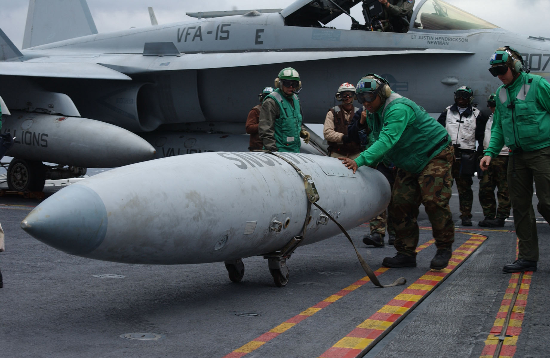 US_Navy_021205-N-0275F-502_removing_a_fuel_tank_from_an_F-A-18C.jpg