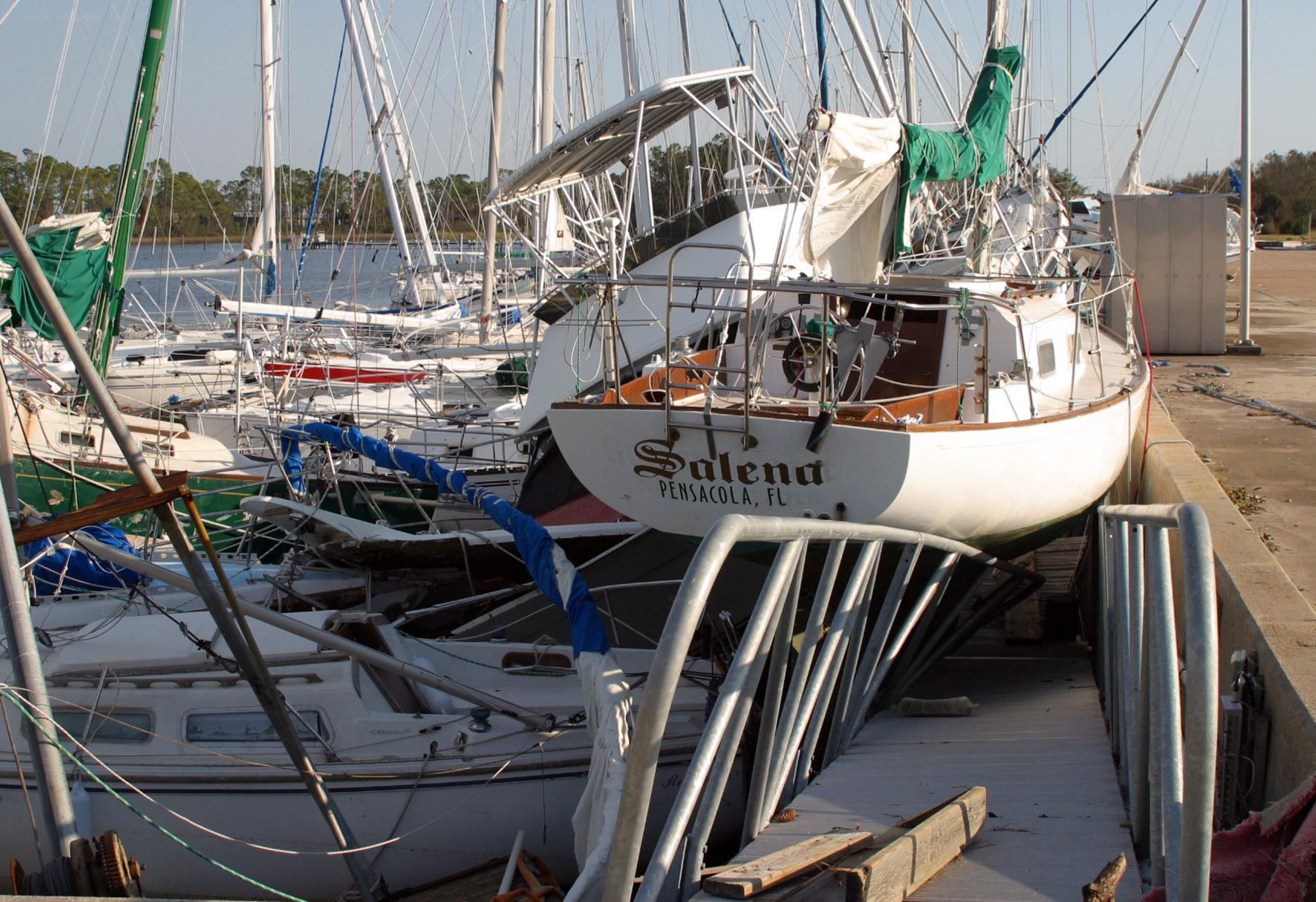 File Us Navy 040918 N 0000w 014 Hurricane Ivan Sunk And Stacked Boats At Bayou Grande Marina On