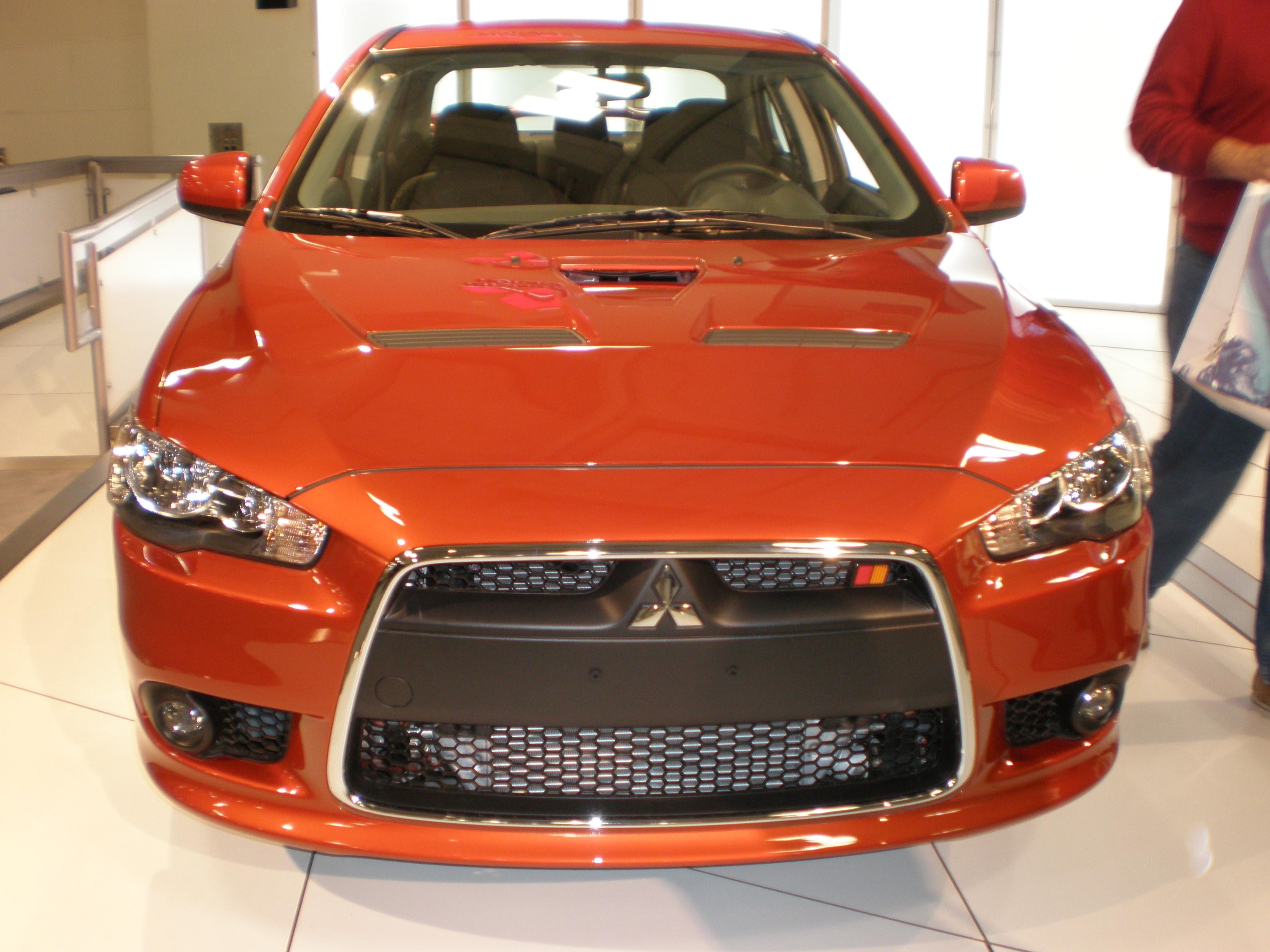 File 2009 orange mitsubishi lancer ralliart sedan front jpg