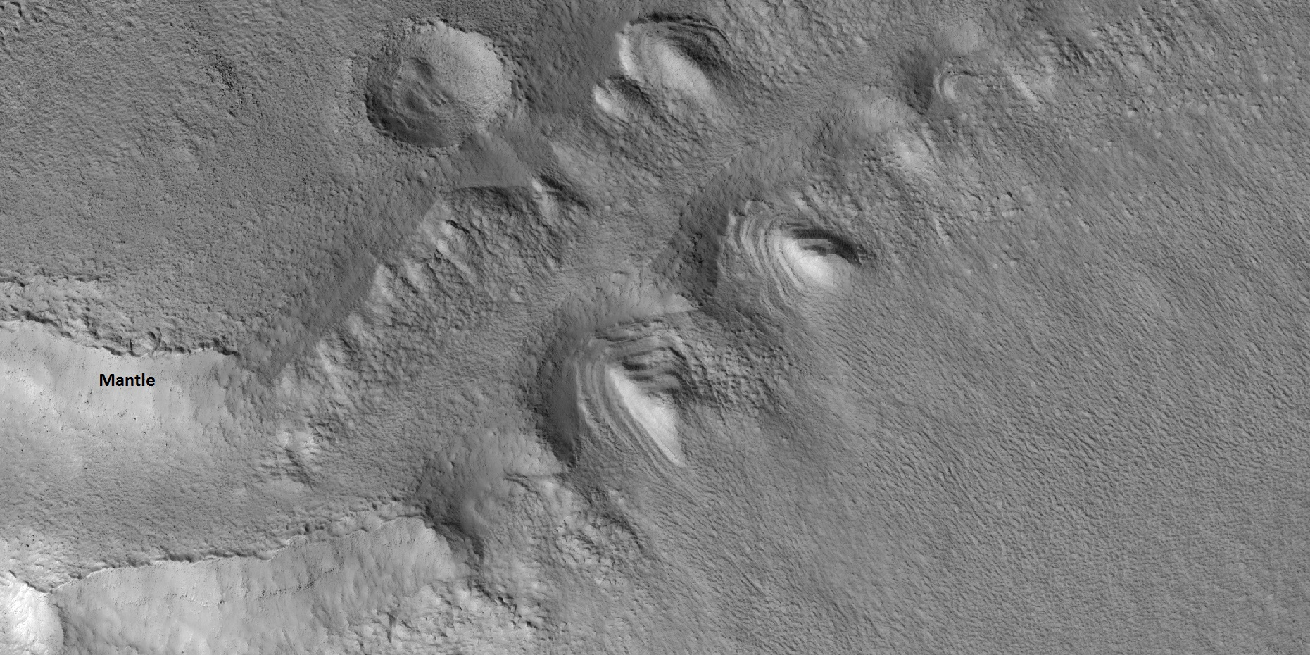 Close view of slopes that contain dipping layered features, as seen by HiRISE under HiWish program