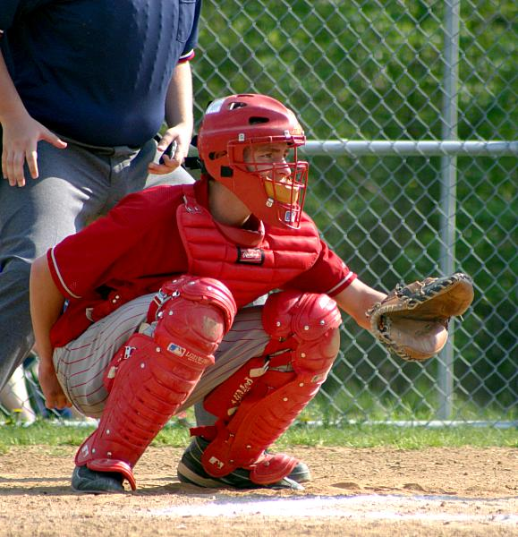 77a55ceab9e2b A catcher in customary squatting position (wearing a