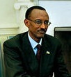 Kagame wearing a suit and Rwandan flag badge during a meeeting with American President George W. Bush