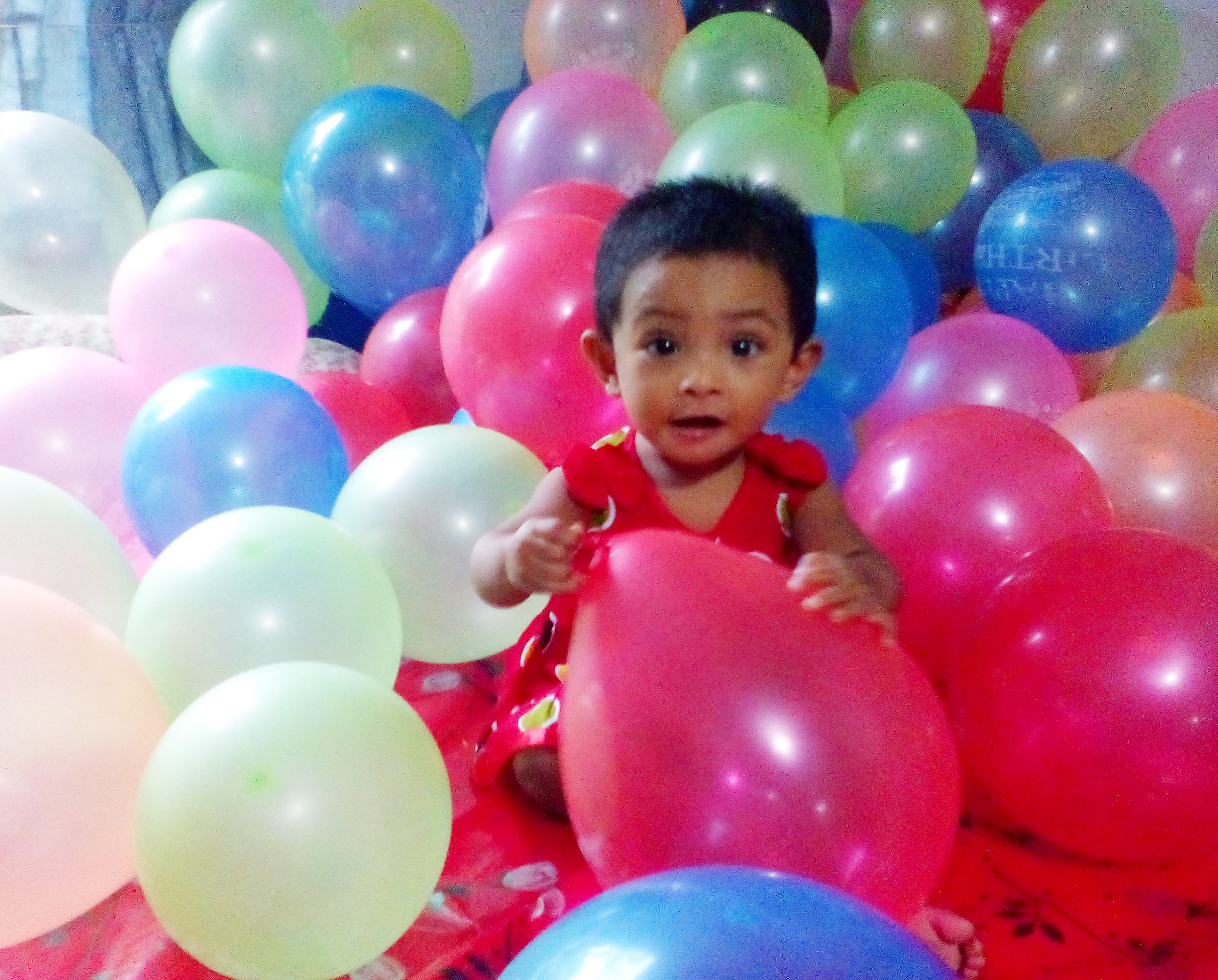 File One Year Baby Is Playing With Birthday Balloons Jpg