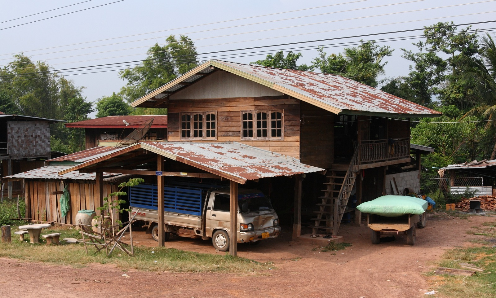 Image gallery laos houses for Stilt homes for sale