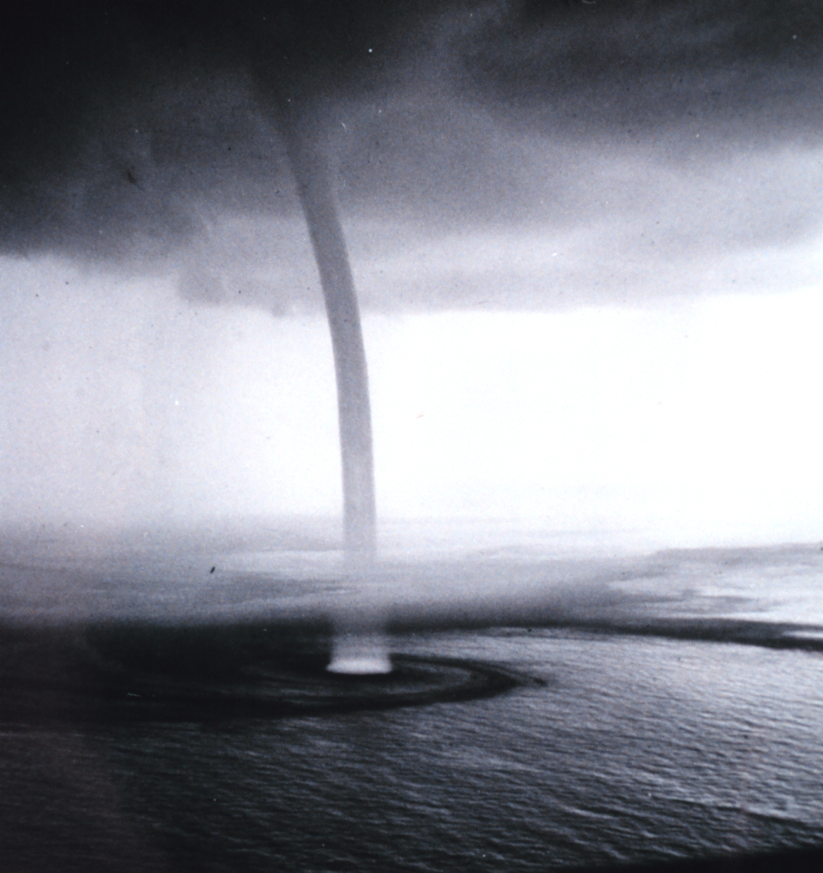 water spouts Define waterspout: a pipe, duct, or orifice from which water is spouted or through which it is carried — waterspout in a sentence.