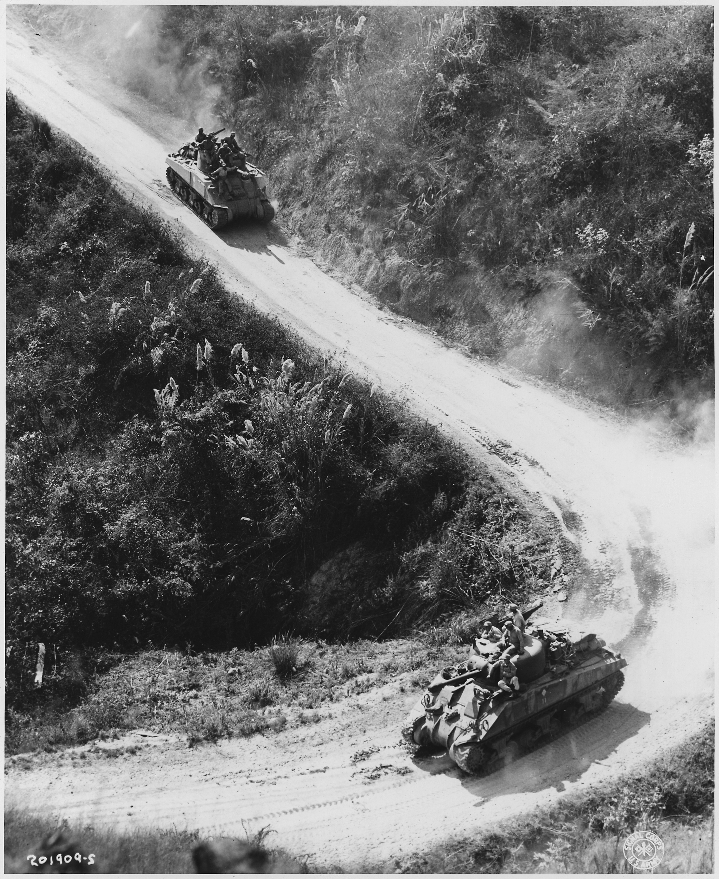 Mountain-climbing U.S. medium tanks, manned by Chinese and American crows, use the Burma Road for the first time... - NARA - 196225