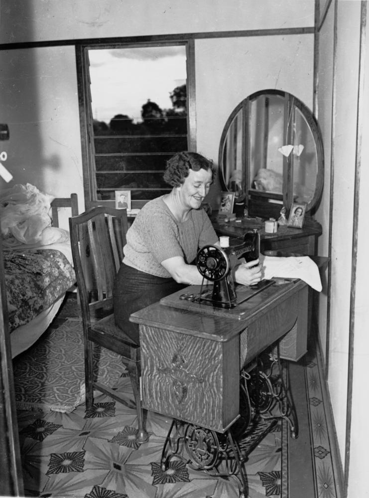 File Statelibqld 1 101812 Woman Seated At A Singer Treadle