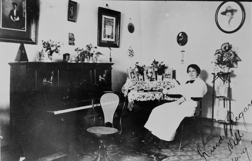 File statelibqld 1 50804 nell sitting at her writing desk - Description of a living room essay ...