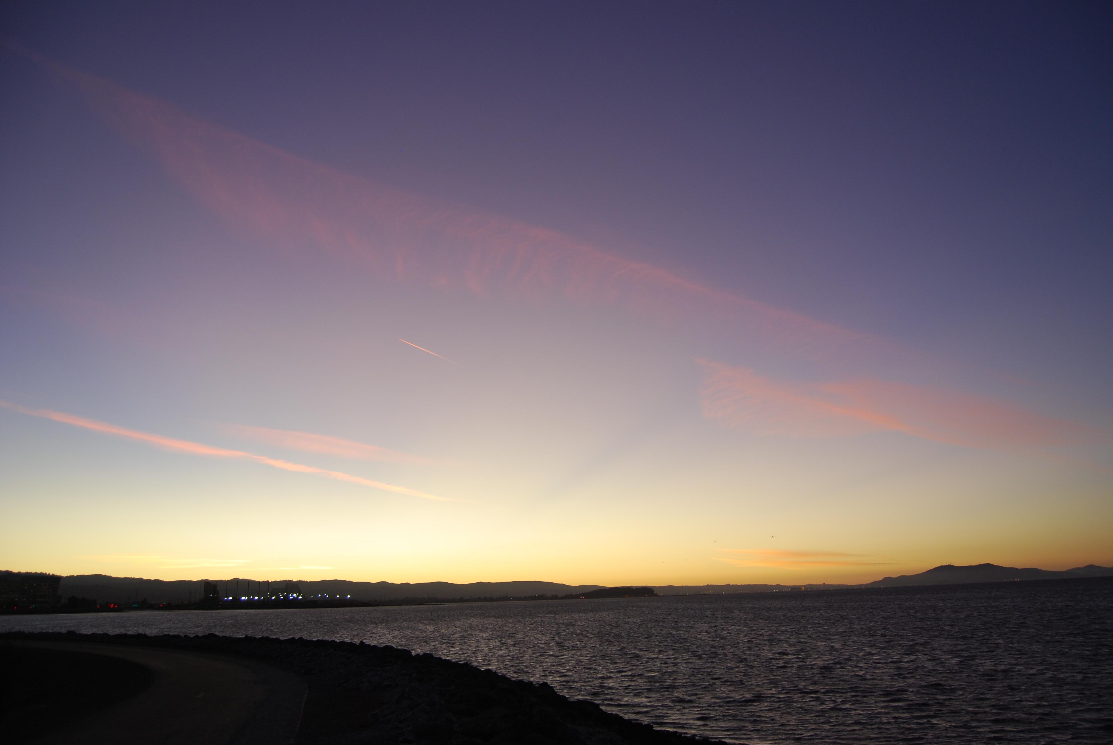 File:Sun-ray, pink clouds, blue sky, yellow horizon seg b ...